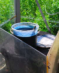 Prepared woad vat standing on top of black bin